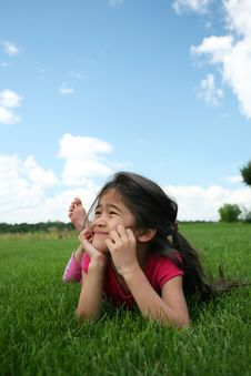 Free Little Girl Lying On Grass Royalty Free Stock Images - 6128509
