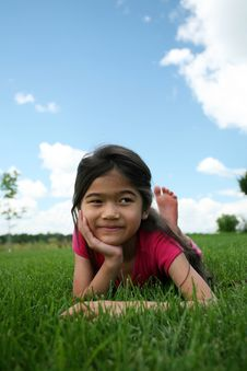 Free Little Girl Lying On Grass Royalty Free Stock Photo - 6128515