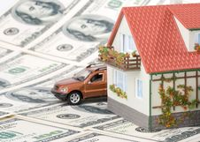 Miniature House And Money. Royalty Free Stock Photo