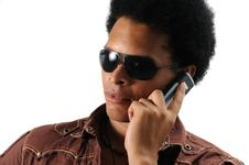 Free Trendy Man Using Cell Phone Royalty Free Stock Images - 6130609