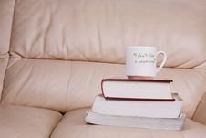 Free Cup Of Coffee On Book Stock Images - 6131794
