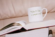 Free Cup Of Coffee On Book Royalty Free Stock Photo - 6131805