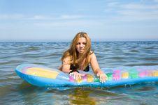 Free Beautiful Girl Swimming On Mattress Royalty Free Stock Images - 6132369