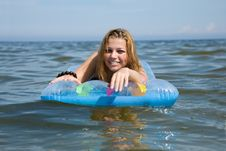 Free Beautiful Girl Swimming On Mattress Royalty Free Stock Image - 6132386