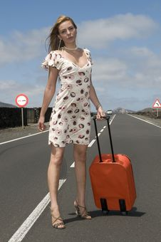 Free Woman On The Road With Her Suitcase Stock Photos - 6132563