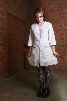 Girl In A Hospital Dressing Gown Stock Photography