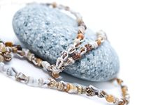 Stone With A Beads Royalty Free Stock Photo