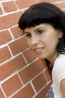 Free Girl Against Brick Wall Royalty Free Stock Photography - 6138357