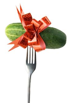 Cucumber With Red Bow On Fork Royalty Free Stock Photo