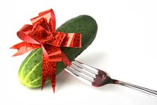 Cucumber With Red Bow On Fork Stock Photos