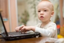 Little Boy Typing Text On Laptop At Home Royalty Free Stock Image