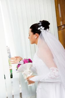 Free Bride Looks Out Of The Window Stock Image - 6140651