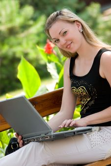 Happy Young Woman With Laptop Royalty Free Stock Photos
