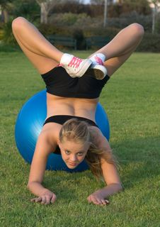 Free Young Girl On Blue Fitness Ball Royalty Free Stock Images - 6148429