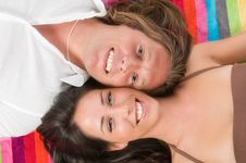 Free Couple Lying On The Colored  Beach Towel Stock Photo - 6148850