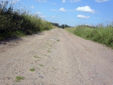 Free Road Through A Field Stock Image - 6151191