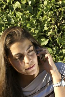 Free Teen Girl Talking On Her Cell Phone Royalty Free Stock Images - 6153339