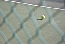 Free Single Tennis Ball Left On The Court Royalty Free Stock Photo - 6153885