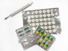 Pills And Thermometer Stock Image