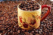 Coffee Mug Full Of Beans Royalty Free Stock Image