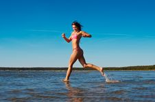 Woman Runnig In Water Stock Photography