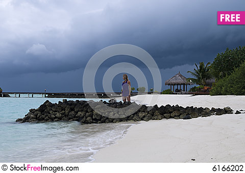 Free Sexy Woman Watching Indian Ocean Stock Photography - 6166202