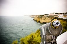 Monocular Pointing To The Sea Royalty Free Stock Images