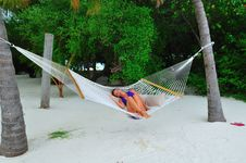 Free Woman Lying On The Hammock Royalty Free Stock Photography - 6165937
