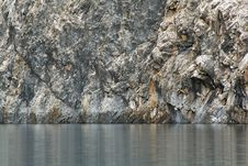 Free Rock Wall Above The Lake Stock Photography - 6165952