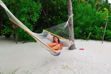 Free Woman Lying On The Hammock Royalty Free Stock Photography - 6165957