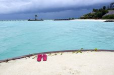 Free Red Thongs On The Sandy Beach Royalty Free Stock Photos - 6166188