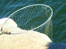 Free Fishing Net On A Rock Stock Image - 6167341
