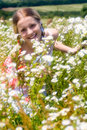Free Girl Surrounded By Flowers Royalty Free Stock Image - 6176226