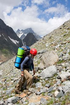 Free Gril Backpacker Traveling On Talus Stock Photos - 6170993