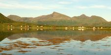 Lofoten S Village  Mirroring At Midnight Royalty Free Stock Image