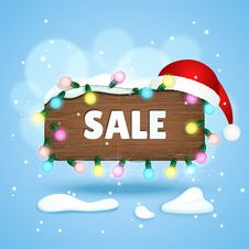 Wooden Sign With Sale Text, Christmas Lights And Christmas Hat Royalty Free Stock Images