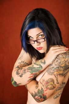 Woman With Tattoos And Crossed Arms Stock Image