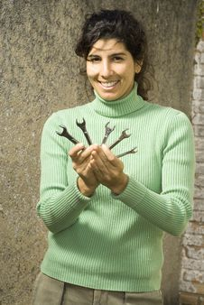 Free Smiling Woman Displays Wrenches - Vertical Royalty Free Stock Photography - 6180557