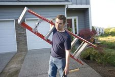 Free Man With Ladder And Hammer - Horizontal Stock Photo - 6180570