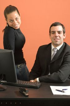 Businessman And Woman Working - Vertical Stock Photo