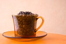 Orange Cup With Coffee Beans Royalty Free Stock Photography