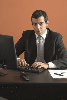 Free Businessman At Desk - Vertical Stock Image - 6180771