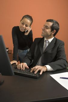 Businessman And Woman Working - Vertical Royalty Free Stock Photography