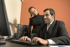 Free Businessman And Woman Working Together - Vertical Royalty Free Stock Images - 6180869