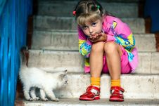 Free Sitting Girl And Kitten Stock Image - 6180871