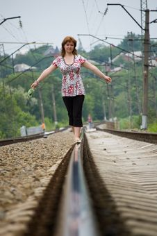 Free The Girl Walks On Rails Royalty Free Stock Photography - 6180907