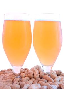 Beer In Glass  And Peanuts  In Shells. Royalty Free Stock Photo
