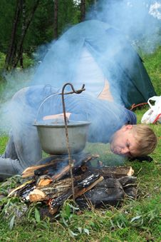 Guy Plants A Fire Stock Images