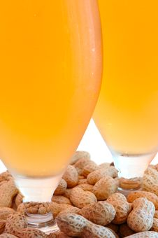 Beer In Glass  And Peanuts  In Shells. Royalty Free Stock Image