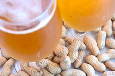 Beer In Glass  And Peanuts  In Shells. Stock Image